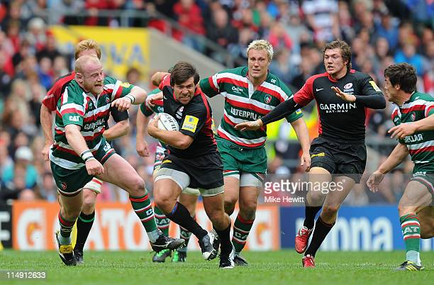 Schalk Brits of Saracens breaks past Dan Cole of Leicester Tigers during the AVIVA Premiership Final between Leicester Tigers and Saracens at...
