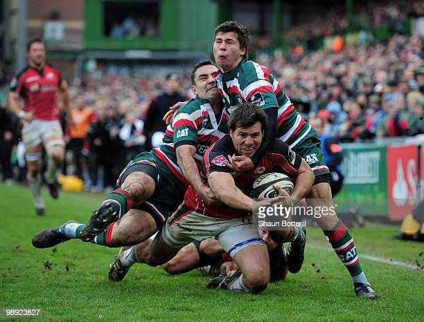 Schalk Brits of Saracens is tackled by Jeremy Staunton and Ben Youngs of Leicester Tigers during the Guinness Premiership match between Leicester...
