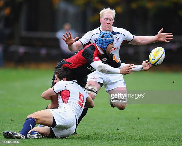 Schalk Brits of Saracens is tackled by Mike Petri and Scott Lavalla of USA during the friendly match between Saracens and USA at the Honourable...