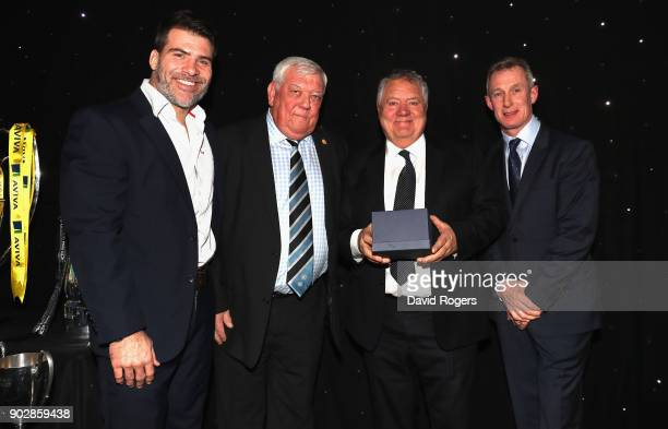 Schalk Brits of Saracens Tony Rowe owner of Exeter Chiefs Rob Howley Lions assistant coach present Max Boyce with a tankard for services to rugby...