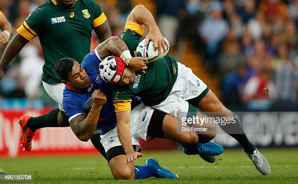 Schalk Brits of South Africa is tackled by Tusi Pisi of Samoa during the 2015 Rugby World Cup Pool B match between South Africa and Samoa at Villa...