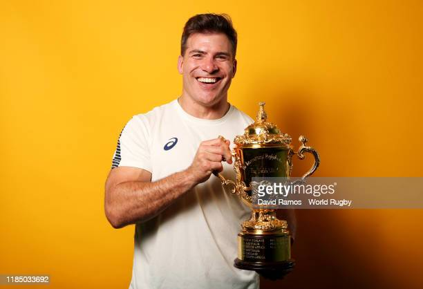Schalk Brits of South Africa poses for a portrait with the Web Ellis Cup following his team's victory against England in the Rugby World Cup 2019...