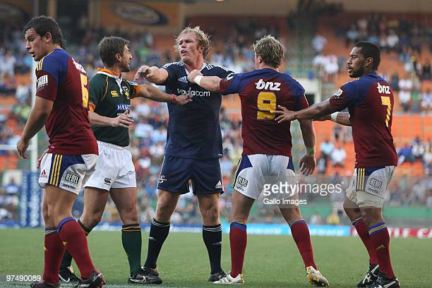 Schalk Burger from the Stormers pushes the referee Matk Lawrence and Jimmy Cowan from the Highlanders away during the Super 14 match between Stormers...