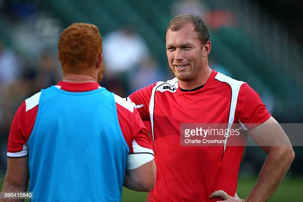 Schalk Burger of Saracens chats to a team mate during the warm up during the pre season friendly match between Saracens and London Scottish FC at...