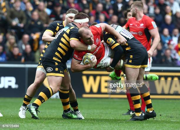 Schalk Burger of Saracens is tackled by Phil Swainston and Danny Cipriani of Wasps during the Aviva Premiership match between Wasps and Saracens at...