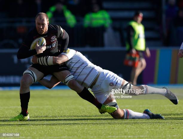 Schalk Burger of Saracens tackled by Mike Williams of Leicester Tigers during the Aviva Premiership match between Saracens and Leicester Tigers at...