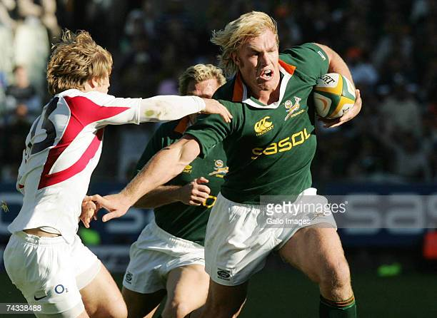 Schalk Burger of South Africa brushes off Mathew Tait of England during the rugby union international test match between South Africa and England at...