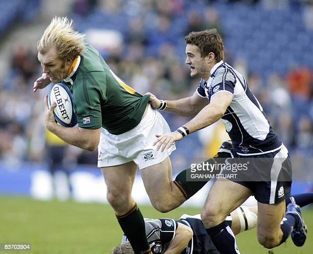 Schalk Burger of South Africa caught by Thom Evans of Scotland during an international test match between Scotland and South Africa at Murrayfield...