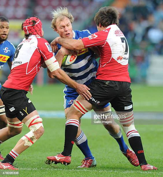 Schalk Burger of the Stormers and Warren Whiteley of the Lions and Warwick Tecklenburg of the Lions during the Super Rugby match between DHL Stormers...