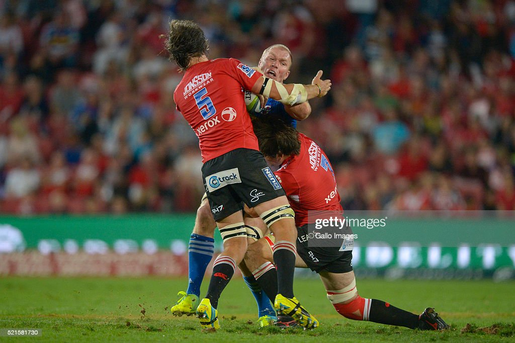 Schalk Burger of the Stormers tackled by Franco Mostert of the Lions during the 2016 Super Rugby match between Emirates Lions and DHL Stormers at Emirates Airline Park on April 16, 2016 in Johannesburg, South Africa.
