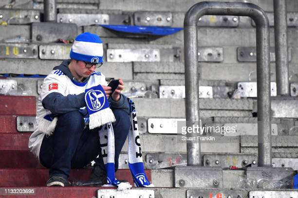 Schalke 04 fan looks dejected following during the Bundesliga match between FC Schalke 04 and Fortuna Duesseldorf at VeltinsArena on March 02 2019 in...