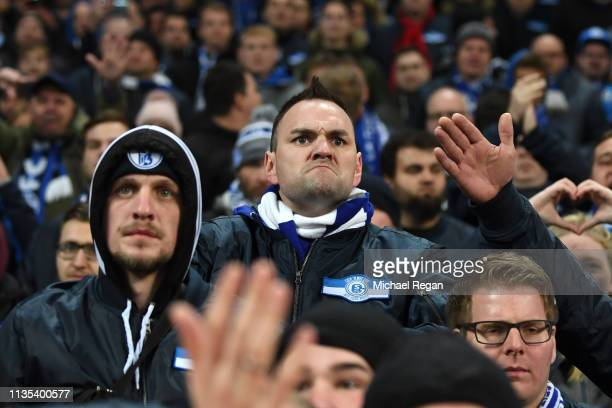 Schalke 04 fan reacts after the UEFA Champions League Round of 16 Second Leg match between Manchester City v FC Schalke 04 at Etihad Stadium on March...