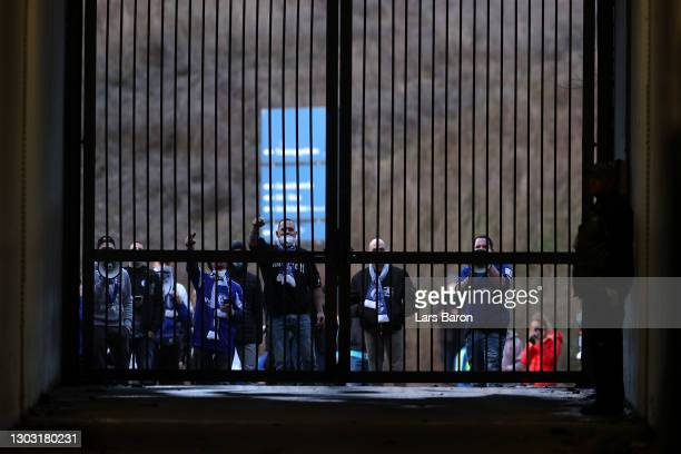 Schalke 04 fans are seen gathered outside the stadium prior to the Bundesliga match between FC Schalke 04 and Borussia Dortmund at Veltins-Arena on...