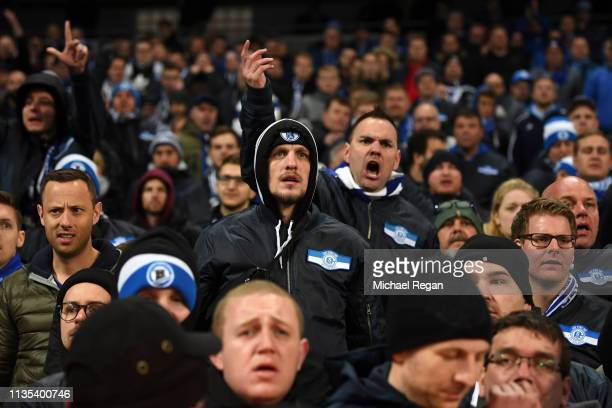 Schalke 04 fans react towards the players after the UEFA Champions League Round of 16 Second Leg match between Manchester City v FC Schalke 04 at...