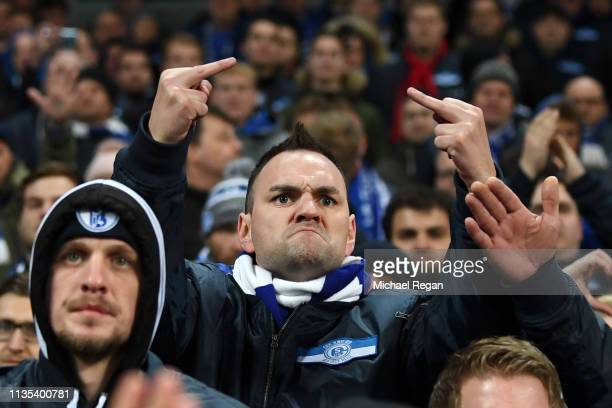 A FC Schalke 04 fans react towards the players after the UEFA Champions League Round of 16 Second Leg match between Manchester City v FC Schalke 04...