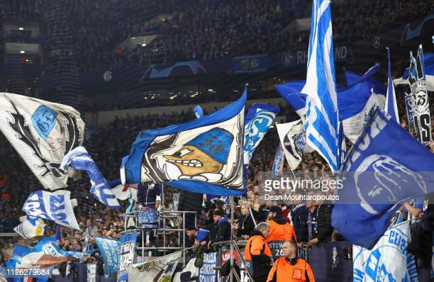 Schalke 04 fans wave flags during the UEFA Champions League Round of 16 First Leg match between FC Schalke 04 and Manchester City at VeltinsArena on...