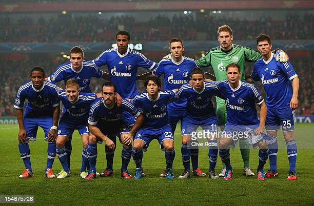 Schalke 04 line up prior to the UEFA Champions League Group B match between Arsenal and FC Schalke at the Emirates Stadium on October 24 2012 in...