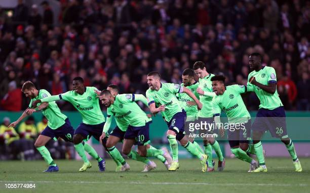 Schalke 04 players celebrate following victory in a penalty shoot out during the DFB Cup match between 1 FC Koeln and FC Schalke 04 at...