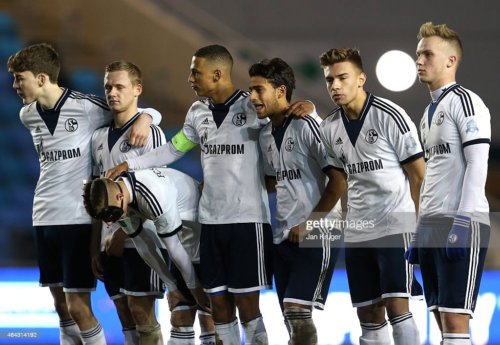 FC Schalke 04 players look on dejected after losing in a penalty shoot out during the UEFA Youth League Round of 16 match between Manchester City FC and FC Schalke 04 at City Football Academy on February 24, 2015 in Manchester, England.