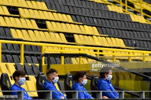 Schalke 04 substitute players sit on the bench during the Bundesliga match between Borussia Dortmund and FC Schalke 04 at Signal Iduna Park on May 16...