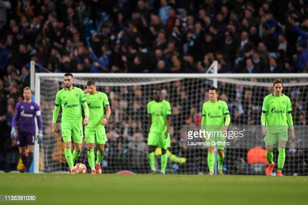 Schalke 04 team look on dejected after Leroy Sane of Manchester City scores his sides third goal the UEFA Champions League Round of 16 Second Leg...