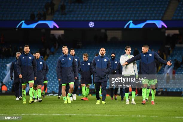 Schalke 04 team react after the UEFA Champions League Round of 16 Second Leg match between Manchester City v FC Schalke 04 at Etihad Stadium on March...