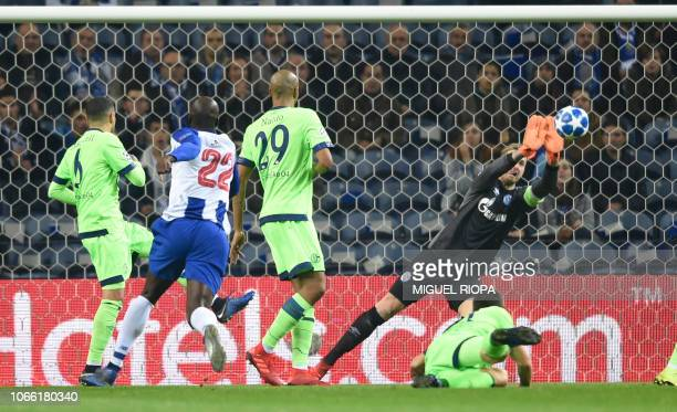 Schalke 04's German goalkeeper Ralf Fahrmann stops a ball from Porto's Portuguese midfielder Danilo Pereira during the UEFA Champions League group D...