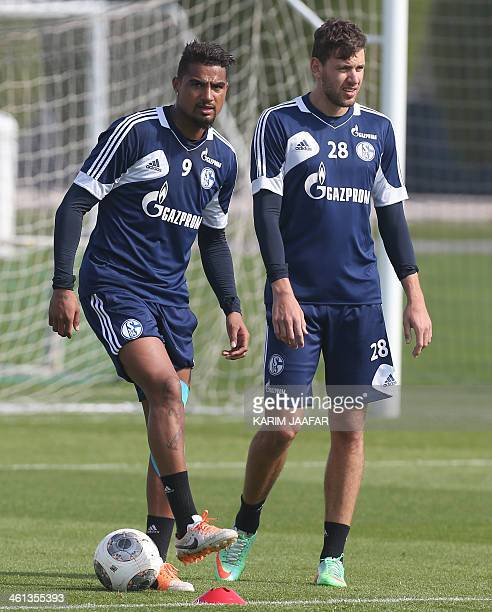 Schalke 04's KevinPrince Boateng and Adam Szalai attend a training session at the Aspire Academy of Sports Excellence in Doha on January 8 2014 AFP...