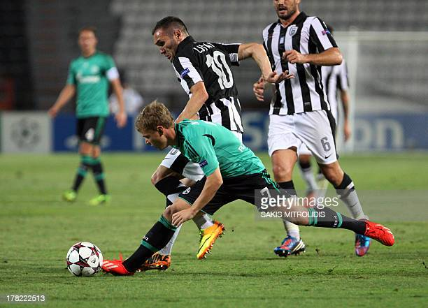 Schalke 04's Max Meyer and PAOK Thessaloniki's Lucas fight fo the ball on August 27, 2013 during an UEFA Champions League play-off second leg...