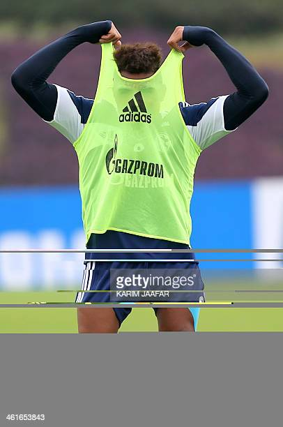 Schalke 04's player Kevin Prince Boateng attends a football training session at the Aspire Academy of Sports Excellence in Doha on January 10 2014...