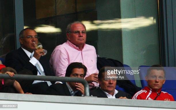 Schalke coach Felix Magath Bayern manager Uli Hoeness and Bayern player Ivica Olic are seen on the stands following the THome cup match between FC...