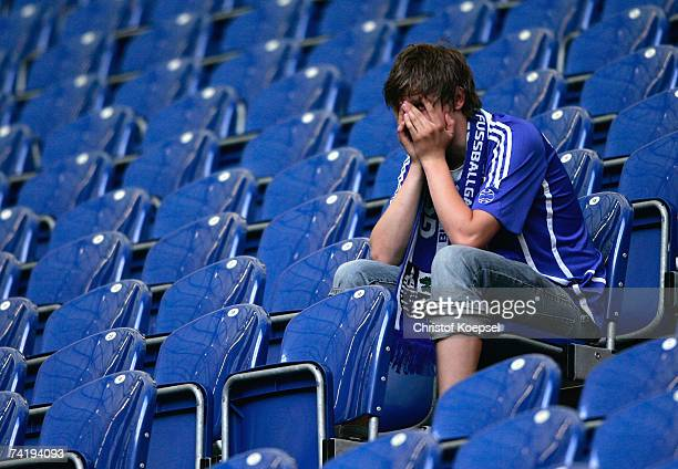 Schalke fan is dejected after Stuttgart won the German title after the Bundesliga match between Schalke 04 and Arminia Bielefeld at the Veltins Arena...