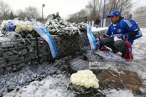 Schalke fan Markus Kotowski watches a grave at the fan cemetery FC Schalke 04 FanFeld on December 7 2012 in Gelsenkirchen Germany