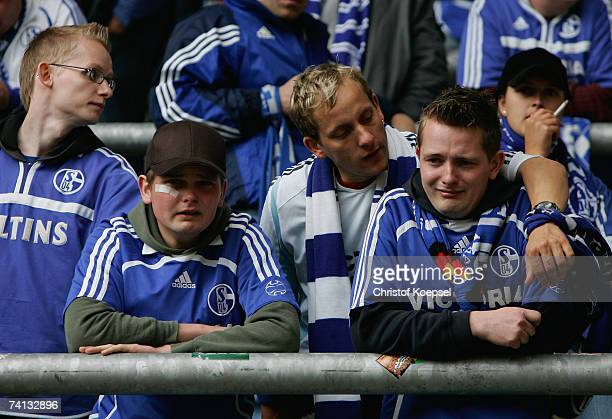 Schalke fans express their disappointment after their team are defeated 02 by Borussia Dortmund in the Bundesliga match at the Signal Iduna Park on...