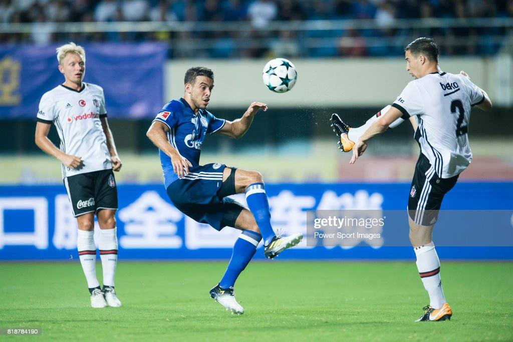 FC Schalke Forward Franco Di Santo (L) trips up with Besiktas Istambul Defender Matej Mitrovic (R) during the Friendly Football Matches Summer 2017 between FC Schalke 04 Vs Besiktas Istanbul at Zhuhai Sport Center Stadium on July 19, 2017 in Zhuhai, China.