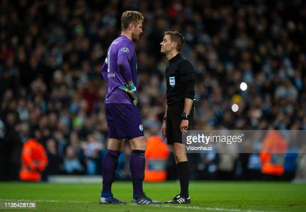 Schalke goalkeeper Ralf Fährmann confronts referee Clément Turpin after he awards a penalty to Manchester City during the UEFA Champions League Round...