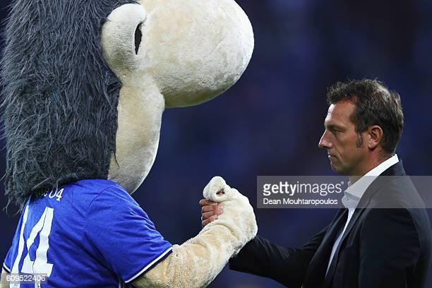 Schalke Manager / Head Coach Markus Weinzierl shakes hands with Erwin the mascot of Schalke prior to the Bundesliga match between FC Schalke 04 and 1...