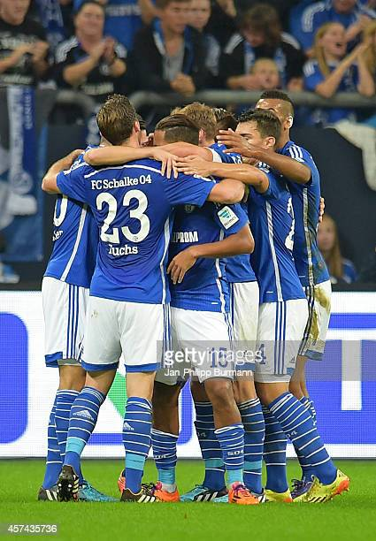Schalke players celebrate after scoring a goal to make it 1-0 during the game between FC Schalke 04 and Hertha BSC on october 18, 2014 in...