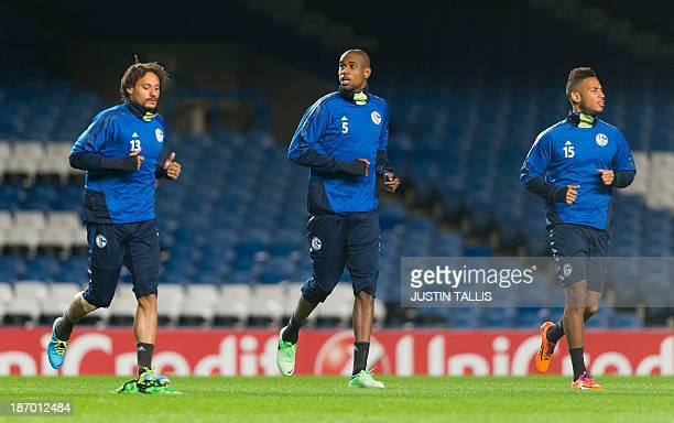 FC Schalke players German American midfielder Jermaine Jones Brazilian defender Felipe Santana and Dennis Aogo warm up during a training session at...