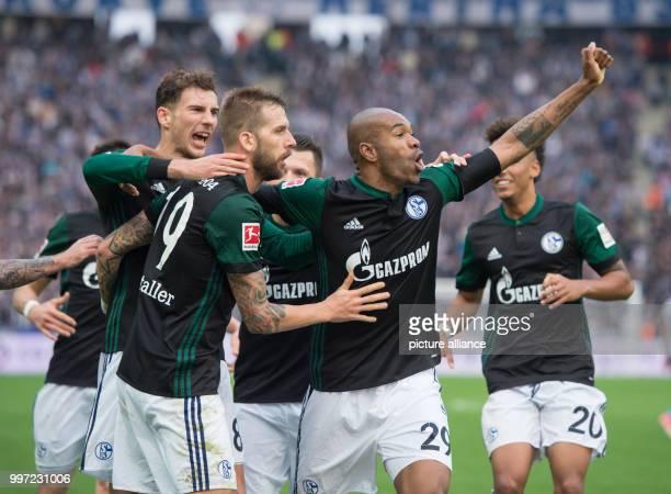 Schalke players Leon Goretzka scorer Guido Burgstaller and Naldo celebrating the 20 during the German Bundesliga soccer match between Hertha BSC and...