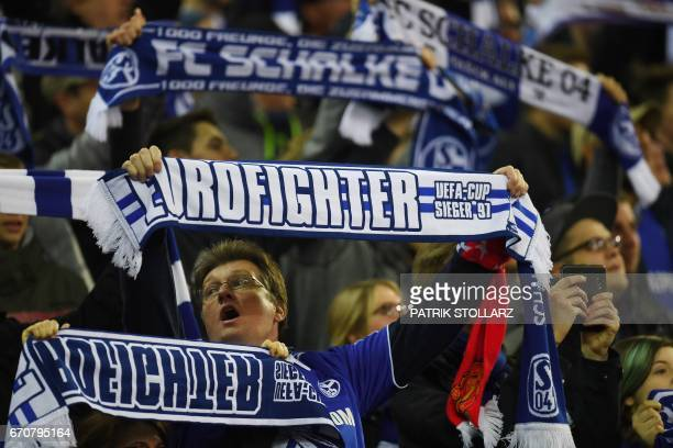Schalke supporters cheer prior to the UEFA Europa League 2ndleg quarterfinal football match between Schalke 04 and Ajax Amsterdam in Gelsenkirchen...