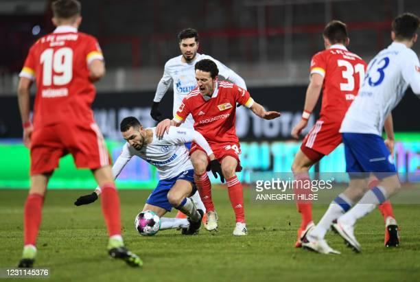Schalke's Algerian midfielder Nabil Bentaleb and Union Berlin's German midfielder Christian Gentner vie for the ball during the German first division...