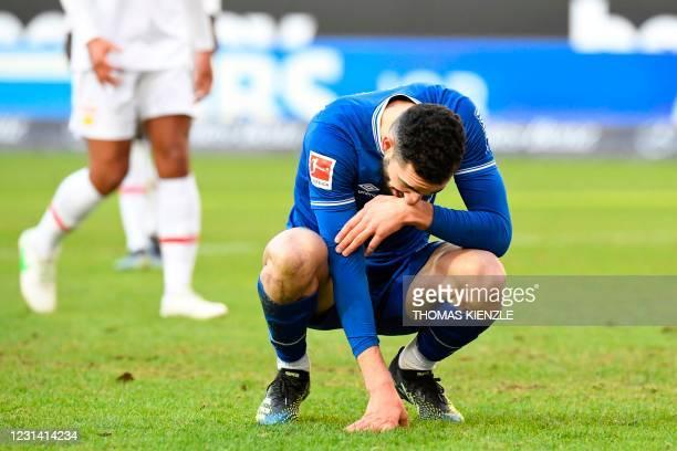 Schalke's Algerian midfielder Nabil Bentaleb reacts after missing a penalty during the German first division Bundesliga football match between VfB...