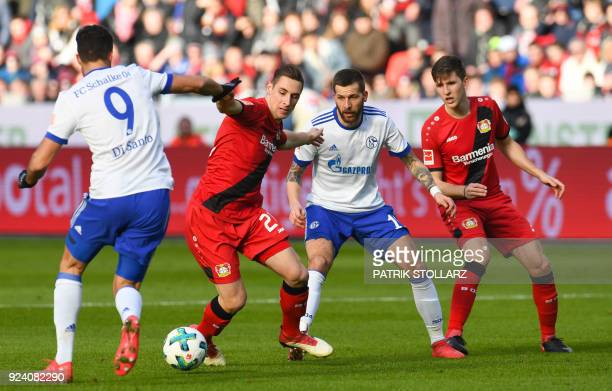 Schalke's Argentinian forward Franco di Santo Schalke's Austrian forward Guido Burgstaller Leverkusen's German midfielder Dominik Kohr and...