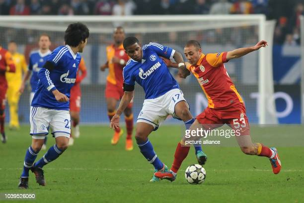 Schalke's Atsuto Uchida and Jefferson Farfan vie for the ball with Galatasaray's Nordin Amrabat during the UEFA Champions League round of 16 second...