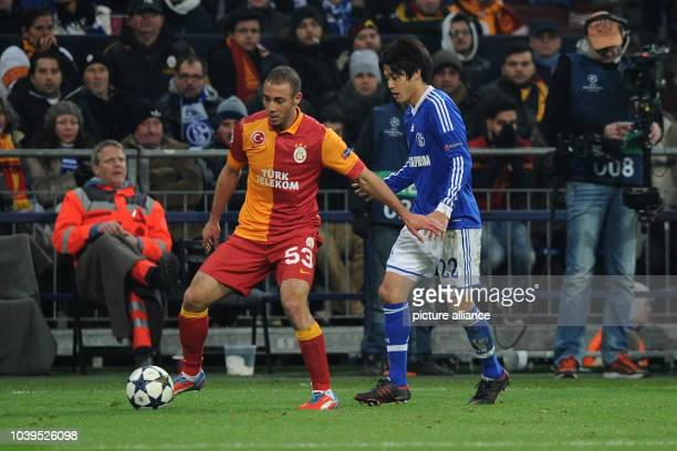 Schalke's Atsuto Uchida vies for the ball with Istanbul's Nordin Amrabat during the UEFA Champions League round of last 16 second leg soccer match...