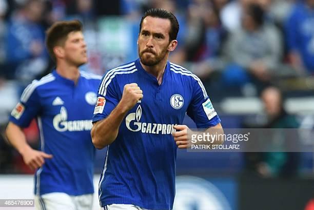 Schalke's Austrian defender Christian Fuchs celebrates scoring duringthe German first division Bundesliga football match FC Schalke 04 v 1899...