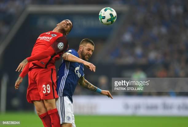TOPSHOT Schalke's Austrian forward Guido Burgstaller and Frankfurt's Spanish midfielder Omar Mascarell vie for the ball during the German Cup DFB...