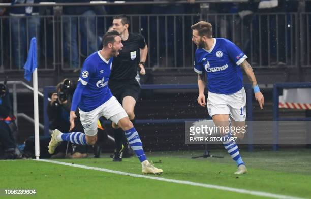 Schalke's Austrian forward Guido Burgstaller celebrates scoring the opening goal with his teammates during the UEFA Champions League group D football...