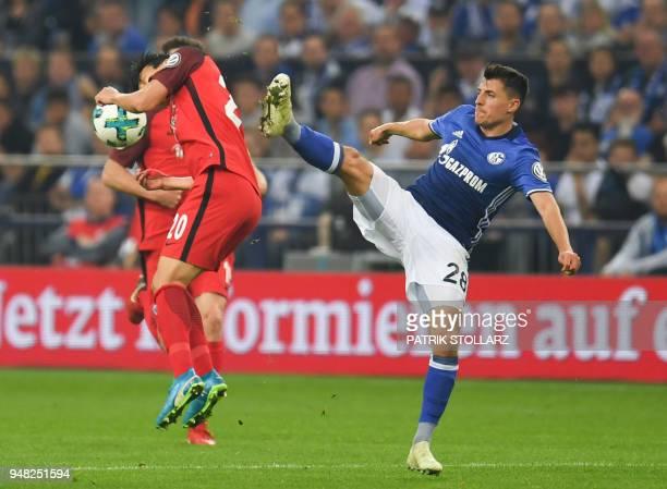 Schalke's Austrian midfielder Alessandro Schoepf and Frankfurt's Japanese midfielder Makoto Hasebe vie for the ball during the German Cup DFB Pokal...